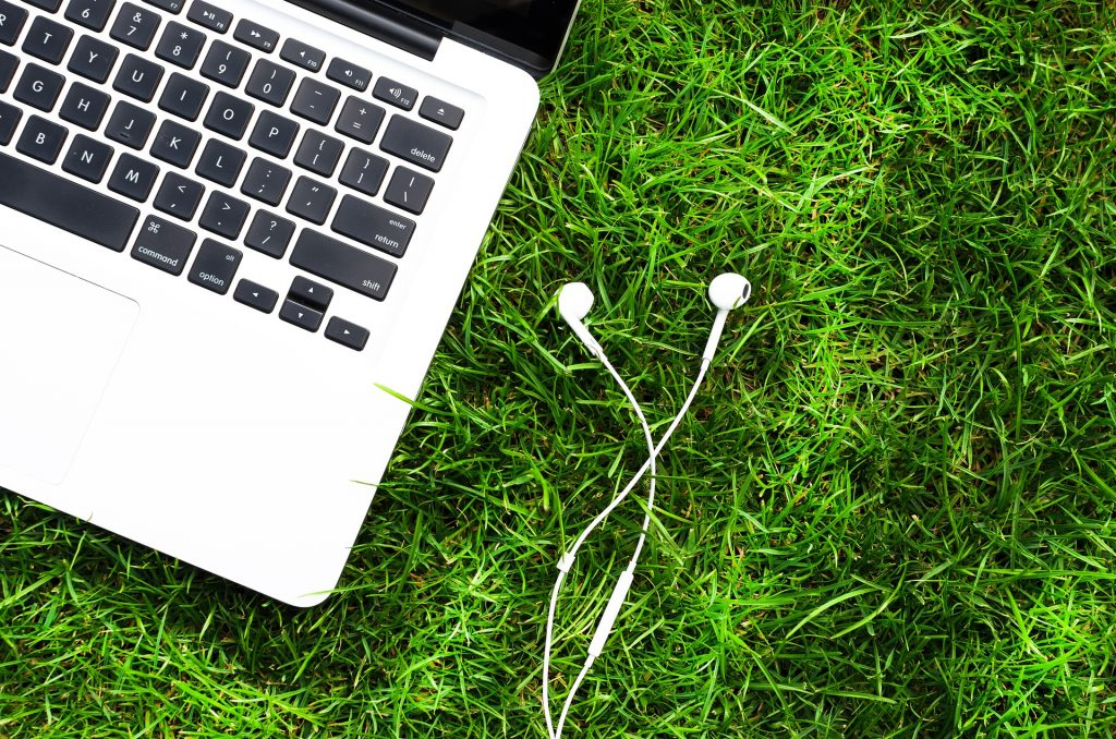 A Mac on a field of grass. Gig work - where independent contractors - work from anywhere in the world - is on the rise.