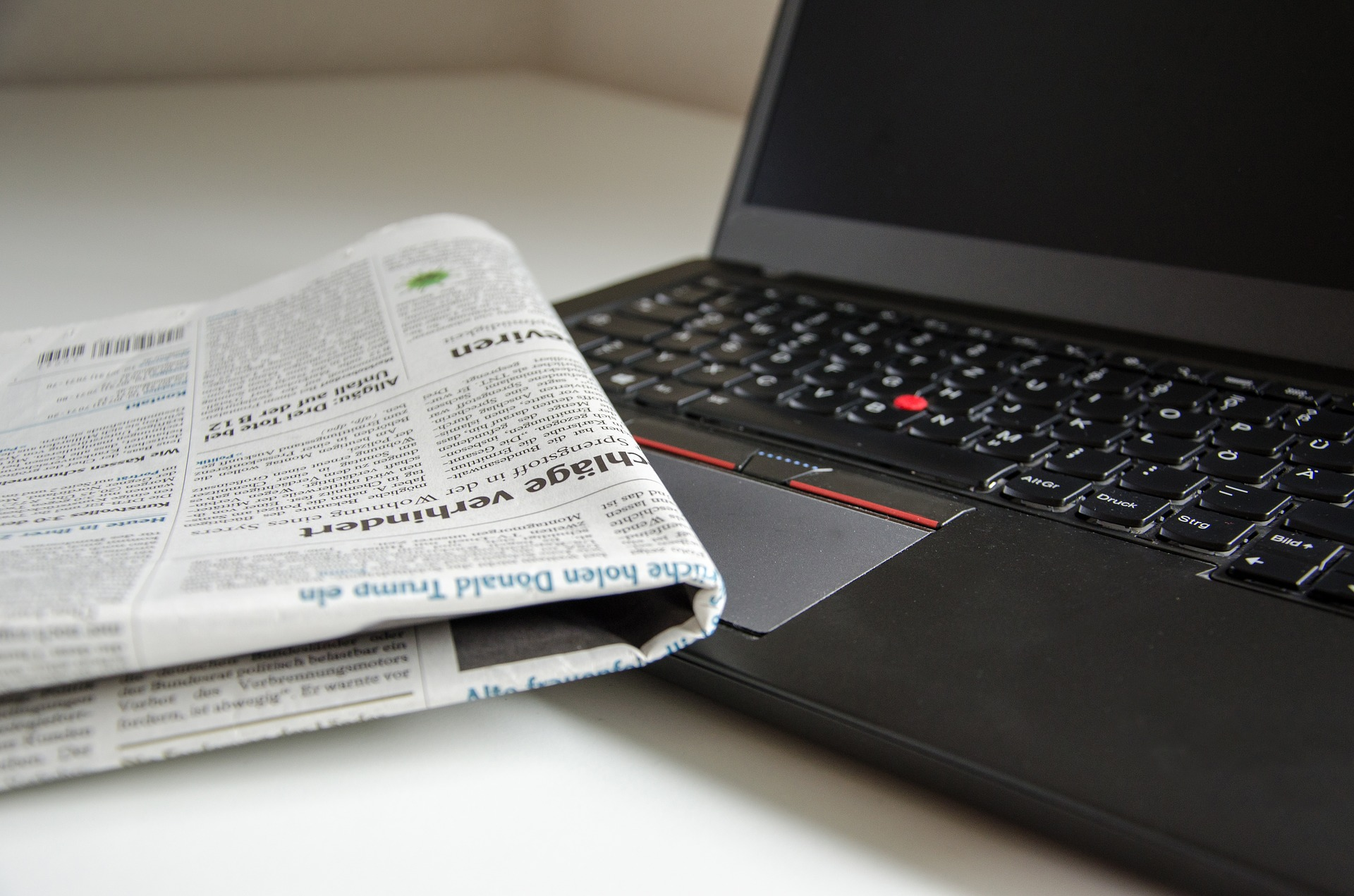 Newspaper on top of laptop keyboard